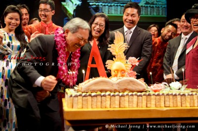 "SF Mayor Ed Lee laughs as he realizes that the candles are ""trick candles"""