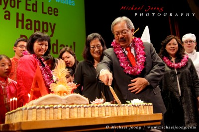 SF Mayor Ed Lee takes the first cut into his cake