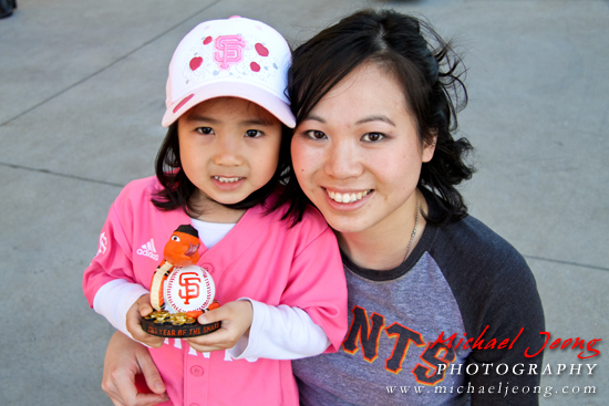 "Mother and daughter at the game with their ""Year of the Snake"" bobblehead."
