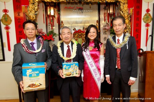 Jessalyn Lau from Hawaii generously receives personalized gold jewelry and she offers her association with a gift in return of leis and treats.